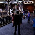 When Wei isn't fighting for his life, he can take in the sights of Sleeping Dogs' Hong Kong. Here, he visits the night market.